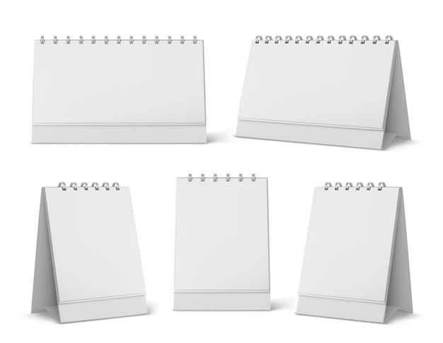 Maqueta de calendario con páginas en blanco y espiral. calendario de papel vertical de escritorio simulacro de vista frontal y lateral aislado sobre fondo blanco. agenda, plantilla de almanaque. ilustración 3d realista, conjunto vector gratuito