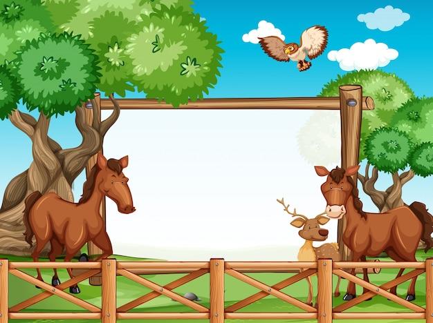 Marco de madera con caballos y ciervos | Descargar Vectores Premium