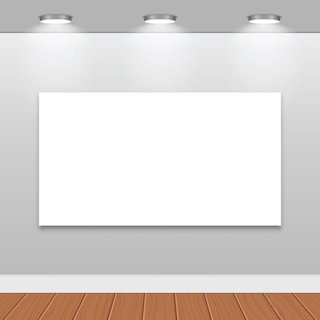 Marcos vacíos blancos en la pared con lámparas halógenas   Descargar ...