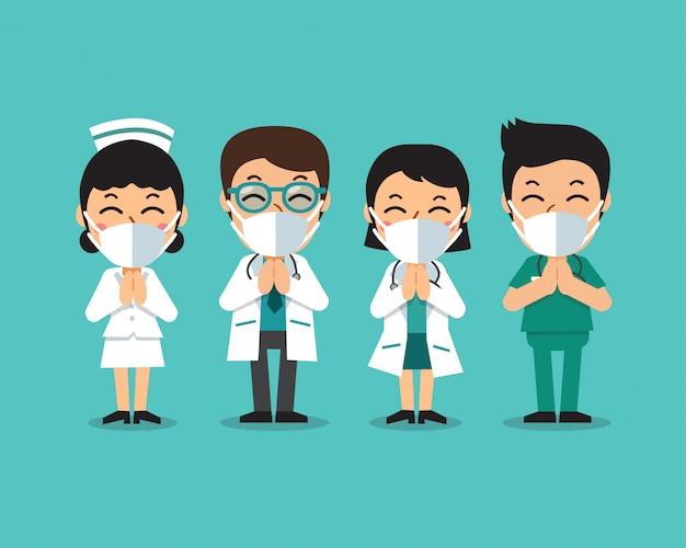 Médicos y enfermeras de dibujos animados con máscaras protectoras Vector Premium
