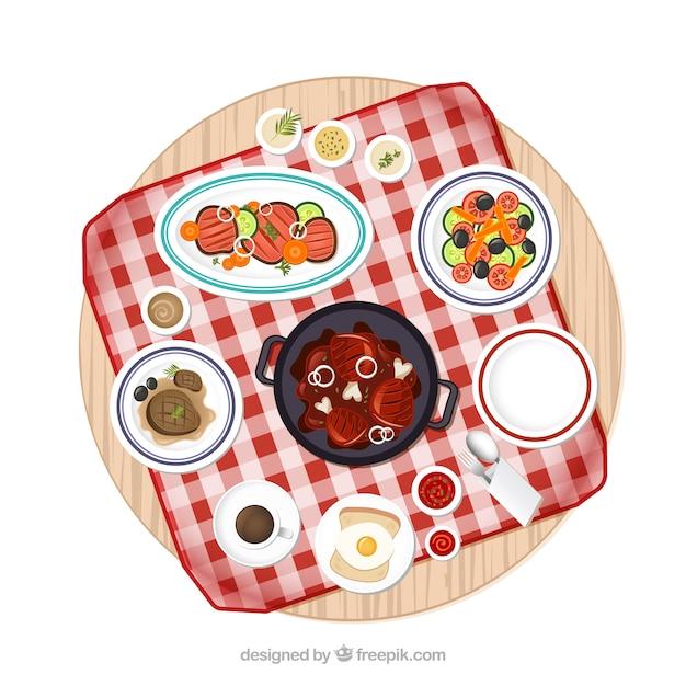 Mesa de picnic con la variedad de platos de comida - Platos para picnic ...