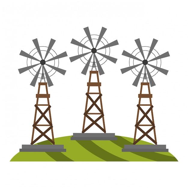 Molinos de viento de la granja en la hierba Vector Premium