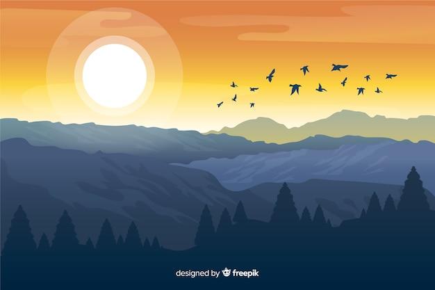 Montañas con sol brillante y pájaros volando Vector Premium