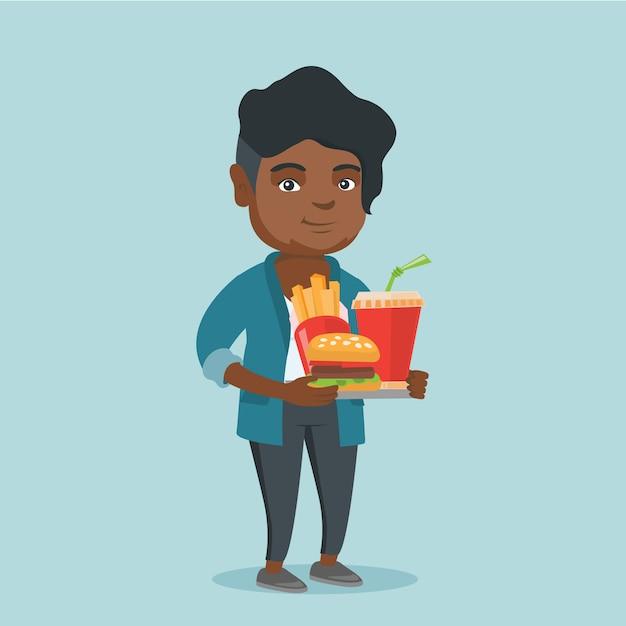 Mujer africana que sostiene la bandeja llena de comida rápida. Vector Premium