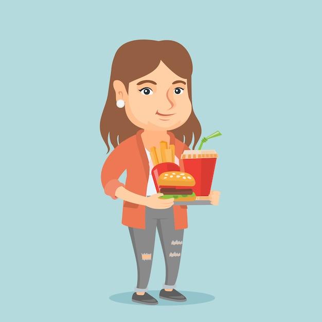 Mujer caucásica con bandeja llena de comida rápida. Vector Premium