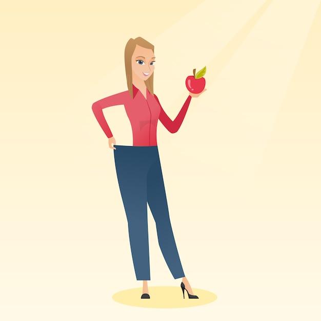 Mujer delgada en pantalones que muestra los resultados de su dieta. Vector Premium