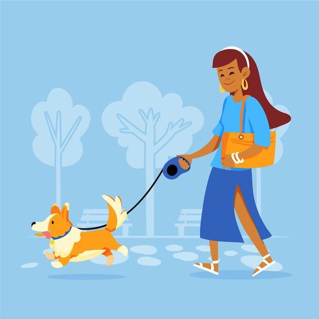 Mujer paseando al perro al aire libre vector gratuito