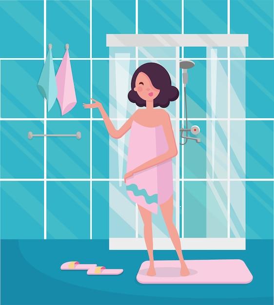Mujer en una toalla rosa de pie en el interior del baño con ducha. Vector Premium