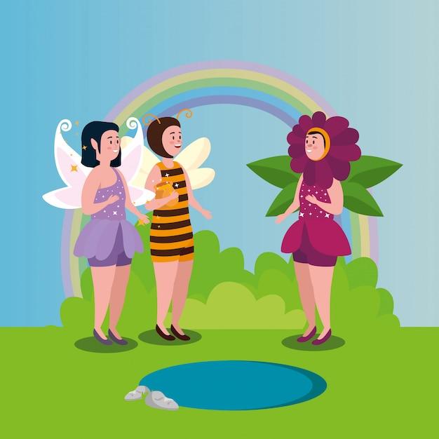 Mujeres disfrazadas de abeja y flor con hada en escena mágica vector gratuito