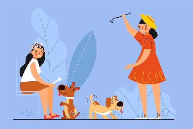 Mujeres jugando con sus perros. vector gratuito