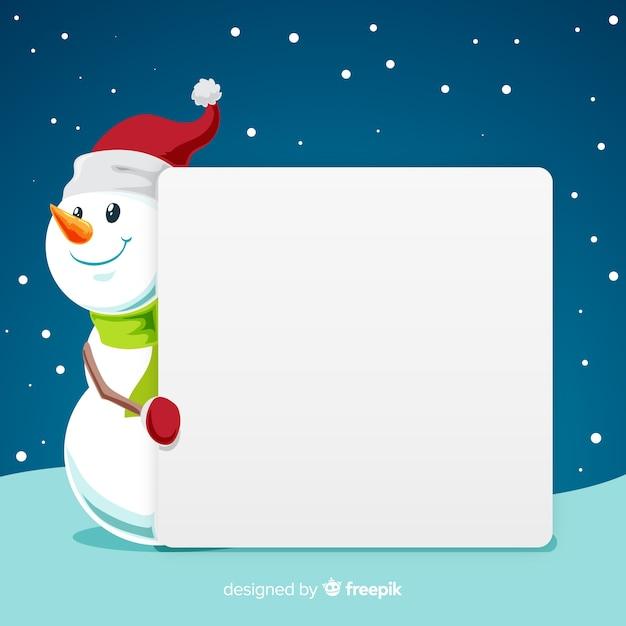 Muñeco de navidad con cartel vacío vector gratuito
