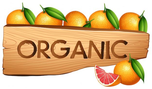 Naranjas y signo orgánico. vector gratuito