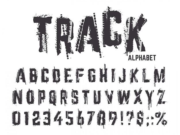 Neumático pistas alfabeto. la textura del grunge pisa letras y números, el neumático de la rueda del coche de la tipografía pone letras al conjunto de símbolos abc. alfabeto y tipo abc, ilustración con textura de neumático negro Vector Premium