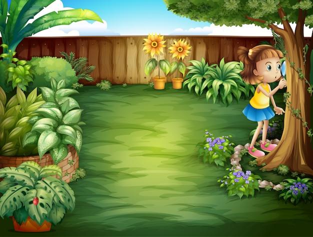 Una niña estudiando las plantas en el jardín. Vector Premium