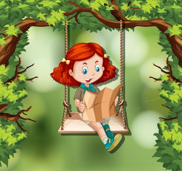 Una niña leyendo el mapa en la selva. vector gratuito