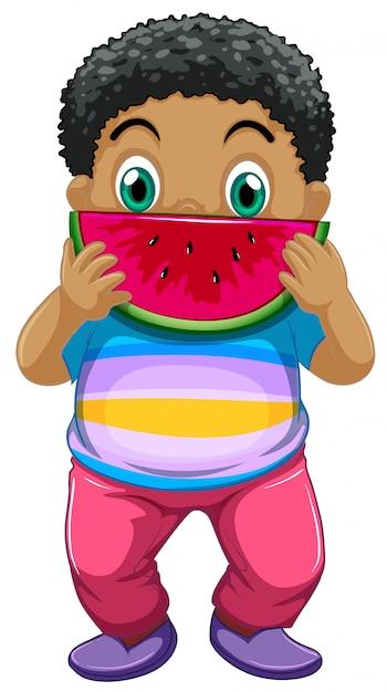 Niño africano comiendo sandia vector gratuito
