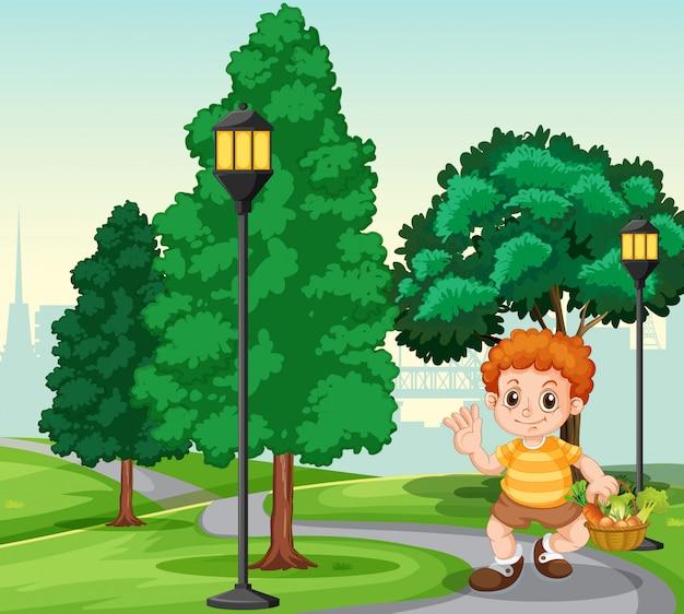 Un niño con canasta en el parque. vector gratuito