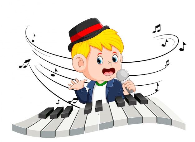 Niño cantando y tocando el piano Vector Premium