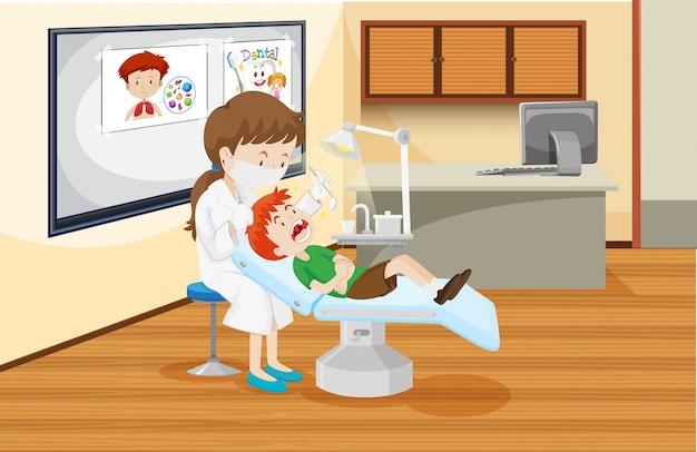 Un niño en la clinica dental vector gratuito