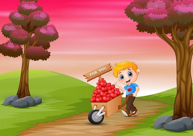 Niño de dibujos animados empujando un montón de corazones en carro de madera Vector Premium