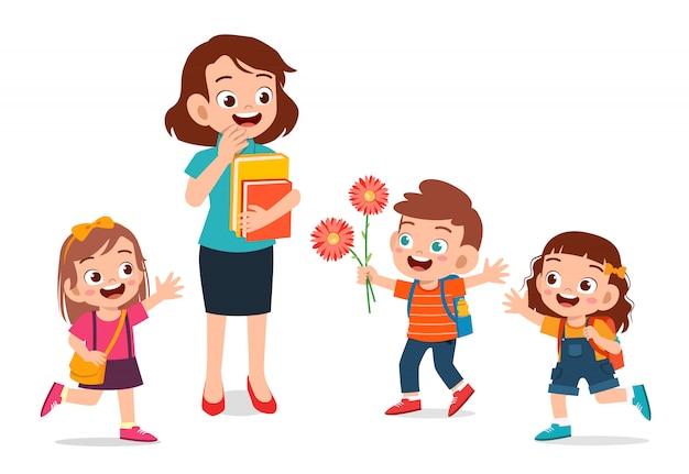 Niño lindo feliz dando flores al maestro Vector Premium