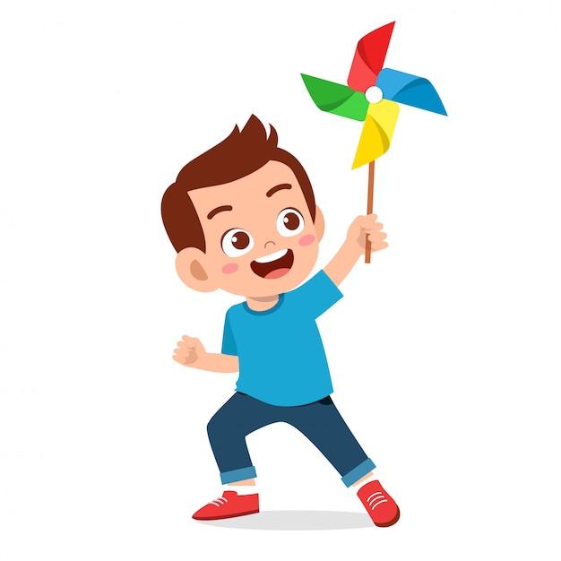 Niño lindo niño feliz sonrisa con juguete Vector Premium