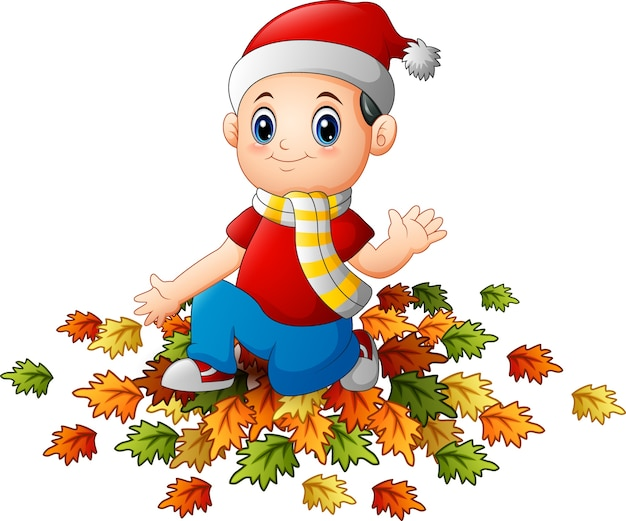 Niño pequeño con sombrero de santa con hojas de otoño   Descargar ...