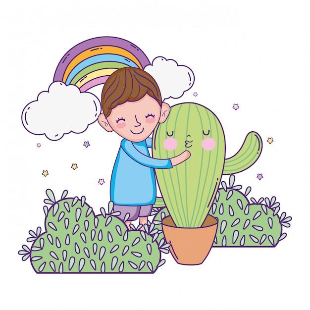 Niño pequeño con el personaje de cactus kawaii. Vector Premium