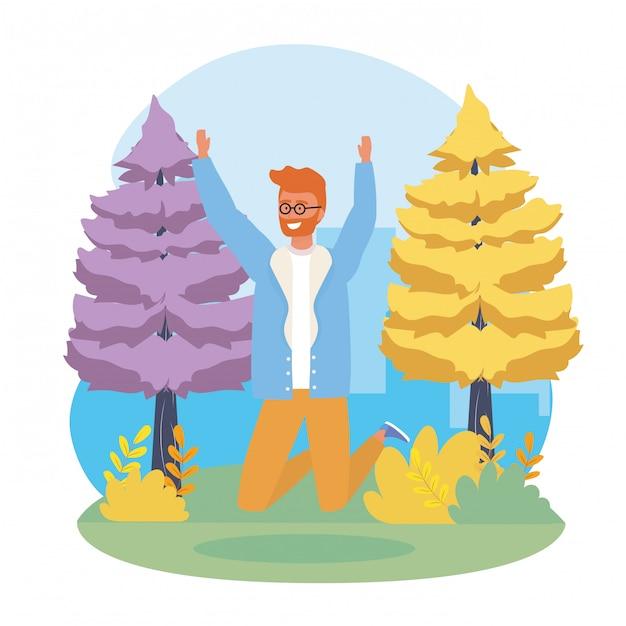 Niño saltando con pinos y plantas. vector gratuito