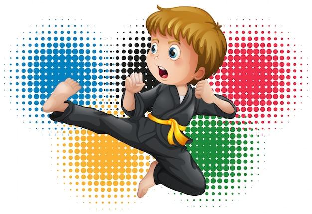 Niño en uniforme de karate negro Vector Premium
