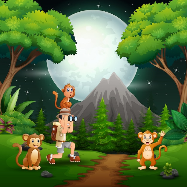 Niño usando binoculares con monos en un bosque Vector Premium