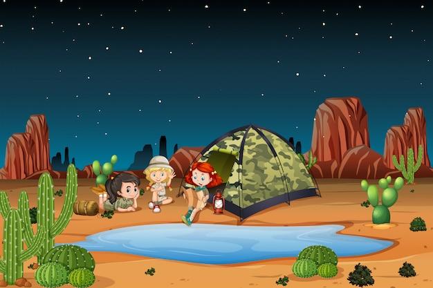 Niños acampando en la ilustración del desierto. vector gratuito