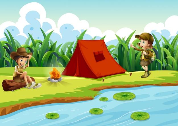 Niños acampando junto al agua con una carpa. vector gratuito
