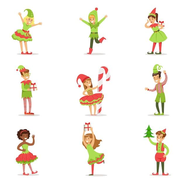 Niños disfrazados de duendes de navidad de papá noel para la fiesta de disfraces de carnaval Vector Premium
