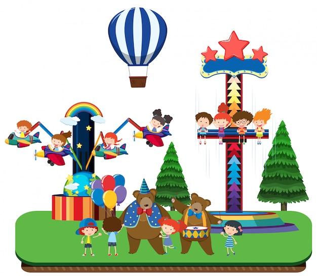 Niños en el parque temático y paseos divertidos | Descargar Vectores ...
