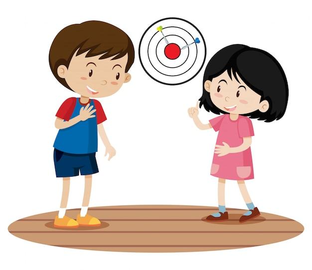 Niños jugando dart game Vector Premium