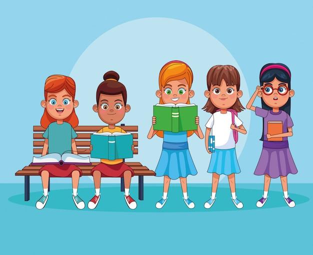 Niños leyendo libros de dibujos animados Vector Premium