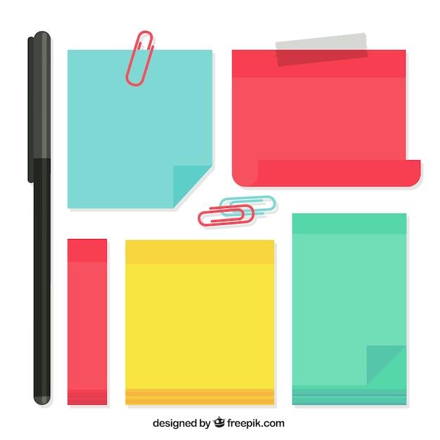Notas adhesivas coloridas con algunos clips y bolígrafo Vector Premium