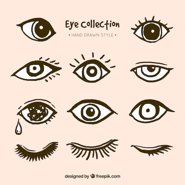 Pack de ojos dibujados a mano vector gratuito