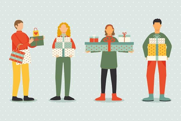 Pack de personas comprando regalos de navidad vector gratuito