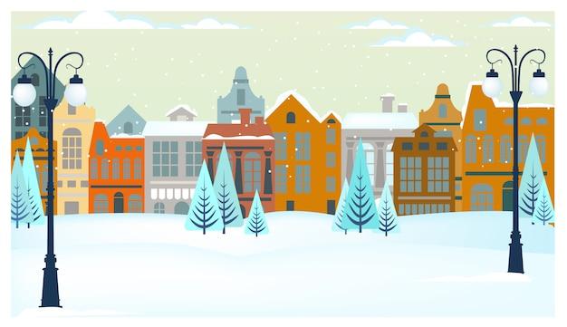 Paisaje invernal con casitas, arboles y farolas. vector gratuito