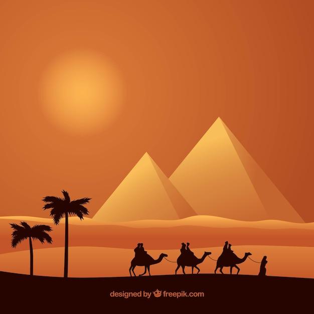 Paisaje de pirámides con caravana vector gratuito
