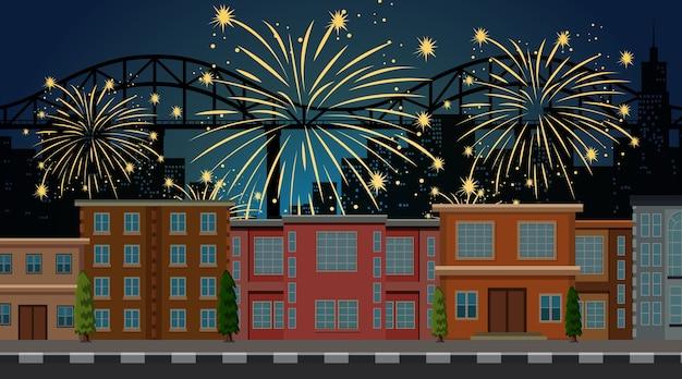 Paisaje urbano con escena de fuegos artificiales de celebración. vector gratuito