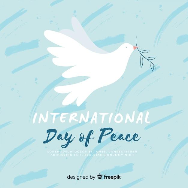 Paloma del día de la paz dibujada a mano vector gratuito