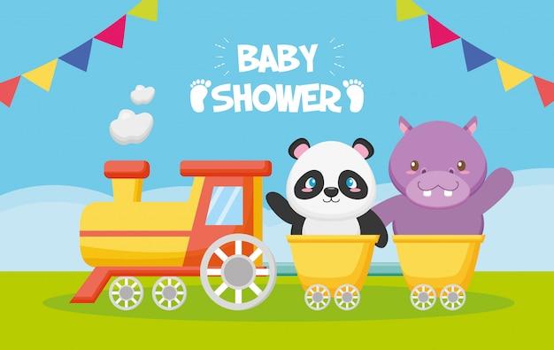Panda y hipopótamo en un tren para tarjeta de baby shower vector gratuito