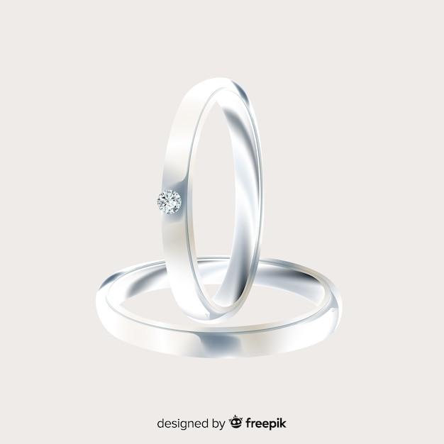 Par de anillos de boda realistas plateados vector gratuito