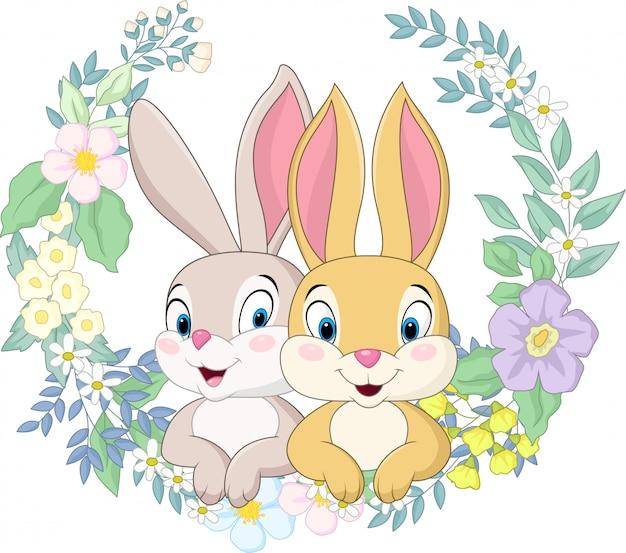 Pareja feliz conejo con fondo de flores Vector Premium