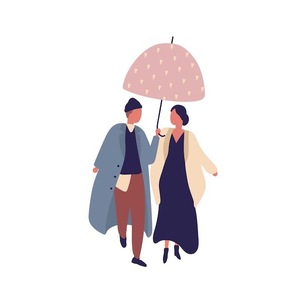 Pareja joven casual de dibujos animados caminando bajo el paraguas en la ilustración plana del día lluvioso. carácter de hombre y mujer en traje de abrigo elegante en la temporada de otoño aislado sobre fondo blanco. Vector Premium
