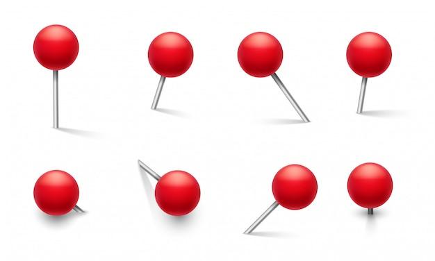 Pasadores de empuje. perno de metal con perilla roja redonda de plástico, chincheta en diferentes ángulos de empuje. conjunto aislado de marcador de escuela de vector 3d Vector Premium