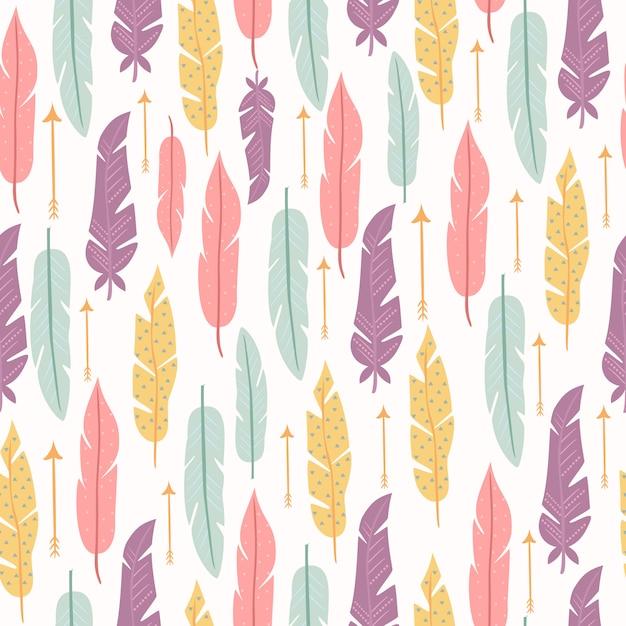 Pastel de patrones sin fisuras con plumas vector gratuito